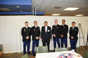 Left to Right: Cadet Mangen, Cadet Flowers, Command Sgt. Maj. (Ret.) Johndrow,  Cadet, Thompson, Cadet Brito, Cadet Schreck