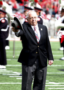 """Former Ohio State Buckeyes head coach Earle Bruce tips his hat as he dots the """"I"""" during the marching band's Script Ohio performance before the game against the Rutgers Scarlet Knights at Ohio Stadium. Greg Bartram-USA TODAY Sports"""
